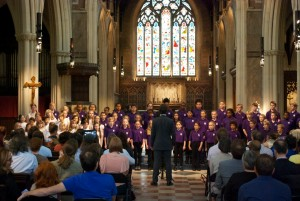 Greg Hallam conducts the massed youth choirs at the 2013 VoL Festival